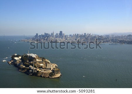 An aerial view of Alcatraz, Bay Bridge and San Francisco skyline.