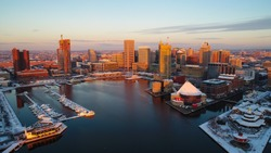 An aerial view of Baltimore's Inner Harbor at sunrise on a cold December morning.