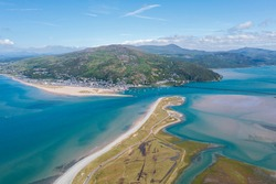 An aerial view of Barmouth, a small welsh seaside town on the mouth of the Mawddach estuary, Gwynedd, Snowdonia National Park, Wales