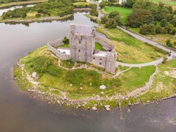 An aerial view of Dunguaire Castle, a 16th-century tower house situated on the south-eastern shore of Galway Bay, thought to be the most photographed castle in Ireland.