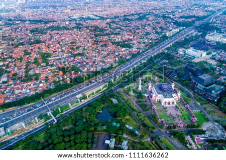 An Aerial View of Jagorawi Toll Road surrounding by Urban Housing and Street. Daily Morning Traffic Jam. Taman Mini, East Jakarta, Indonesia, Asia