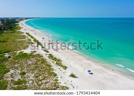 Photo of  An Aerial View of the Beautiful White Sand Beach on Anna Maria Island, Florida. View South down the Island towards Bradenton Beach from Holmes Beach.