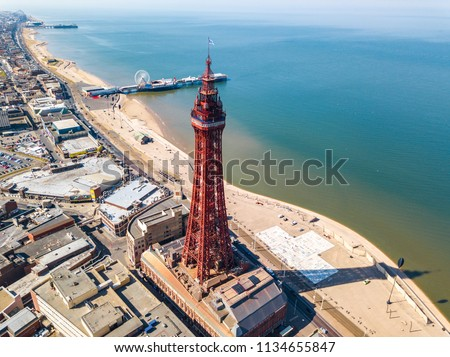 An aerial view of the Blackpool Tower with the Central pier in the background located in Blackpool, UK #1134655847