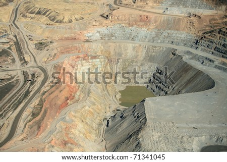 An aerial view of the dikes at an open pit copper mine