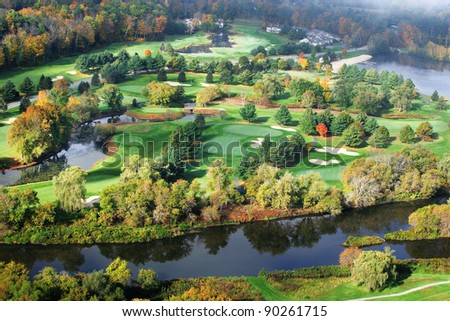 An aerial view of the fairway and green at a resort golf course