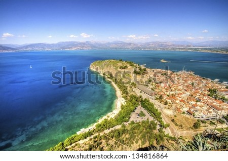 An aerial view of the gorgeous city Nafplio, in Greece which was the first capital of Greece. Palamidi castle and Bourtzi are some of the landmarks of Nafplio.
