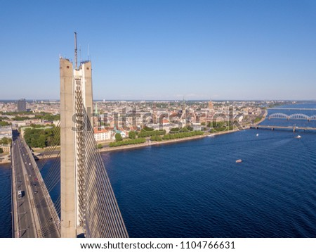 An aerial view of the Vansu bridge or suspension bridge that spans the river Daugava in the Latvian capital of Riga. #1104766631