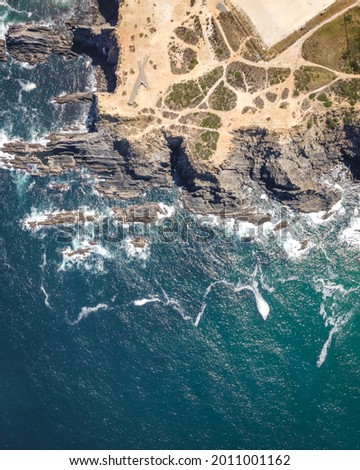 An aerial view of waves breaking on the cliffs at Cabo de Farol Sardao facing the Atlantic Oce Foto stock ©