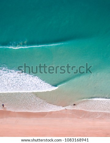 An aerial view of waves crashing on Cable Beach in Broome, Western Australia.