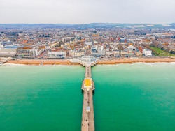 An aerial view of Worthing Pier, a public pleasure pier in Worthing, West Sussex, England, UK