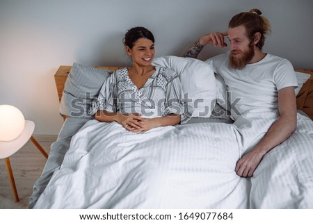 An affectionate couple spending the day in bed