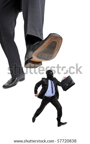 An affraid burglar running away from a big foot isolated on white background