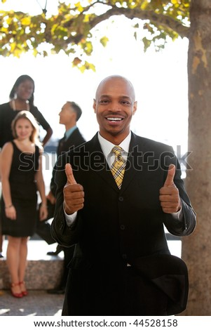 An african american business man with thumbs up