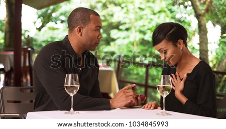 An African American couple get engaged