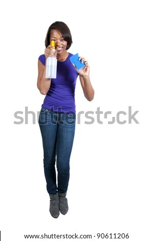 An African American glove wearing beautiful woman or maid cleaning house with a sponge and spray bottle with cleaner
