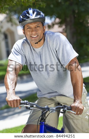 An African American man couple riding bicycle in the summer