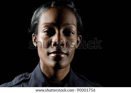 an African-American police officer working the night shift.