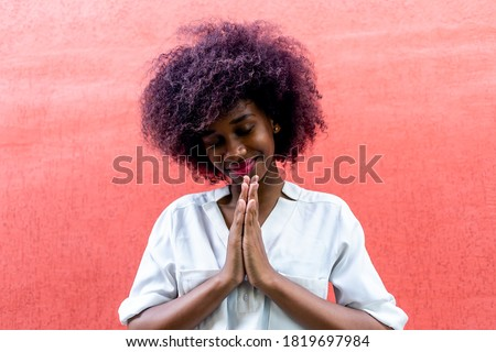 An African American woman makes a gesture of gratitude Stockfoto ©