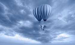 An african elephant flying in the sky with hot air balloon amazing cloudy sky in the background