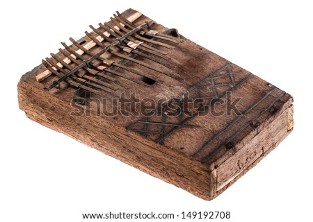 an african instrument named Mbira,  that consists of a wooden board with attached staggered metal keys #149192708