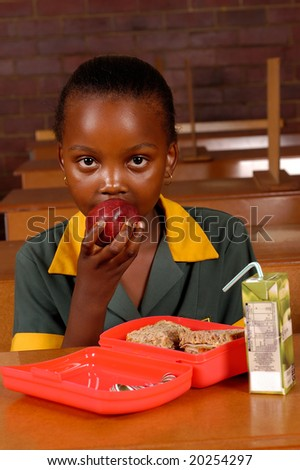 An African student having a healthy lunch