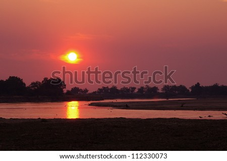 An African Sunset on the Luangwa river, South Luangwa Valley, Zambia