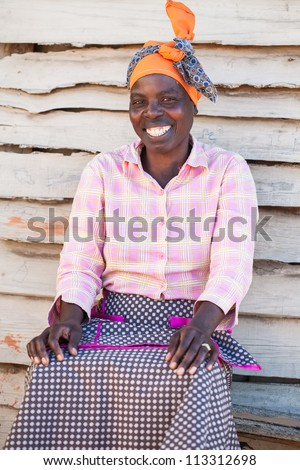 An African woman outside of her home