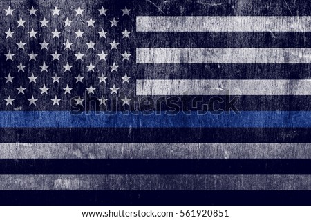 An aged textured law enforcement support flag with a thin blue line.
