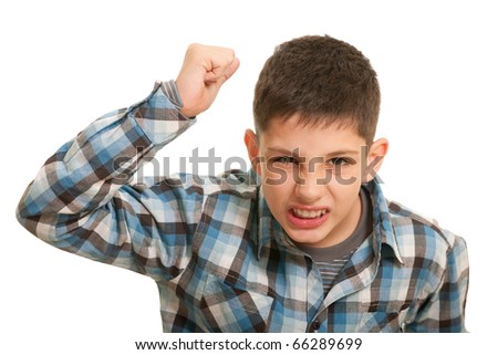 An aggressive guy with his fist risen up attempts to hit; isolated on the white background