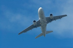 An Air France Airbus A318 rotating towards the east right after taking off from Schiphol Airports runway 09.