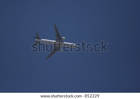 An airliner flying overhead.