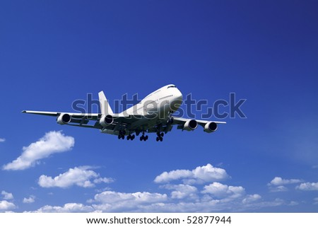 An airplane flying in the blue sky - stock photo
