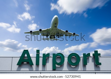 An airplane flying over the airport