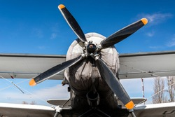 AN-2 airplane - front view: propeller with four blades, wing and wheels
