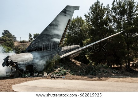 Stock Photo an airplane tail in a plane crash site