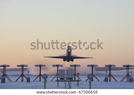 An airplane taking off on a cold winters morning