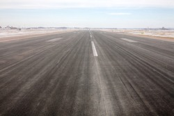 An Airport runway during winter