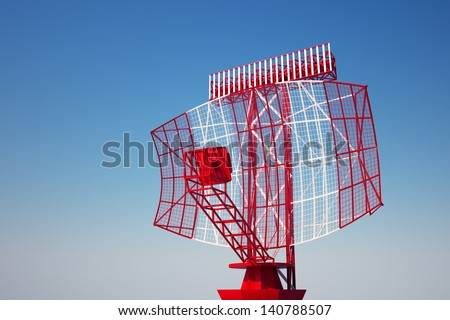 An airport surveillance radar on a bright blue sky background. Front view.