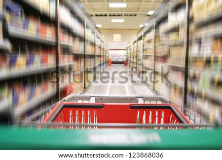 an aisle in a grocery store showing cereals and canned food
