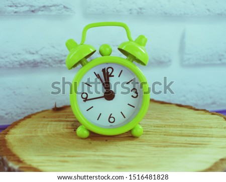 An alarm clock is a clock that is designed to alert an individual or group of individuals at a specified time