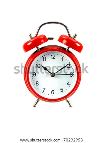 An alarm clock isolated ahgainsdt a white background