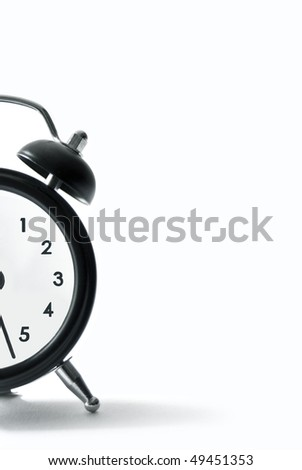 an alarm clock on white background