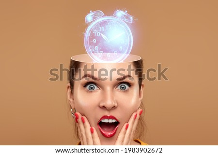 An alarm clock rings in the head of a beautiful girl. The concept of being late, punctual, perseverance, absent-mindedness, morning preparations Stock photo ©