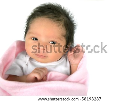 An alert newborn baby girl on a white background ith copy space