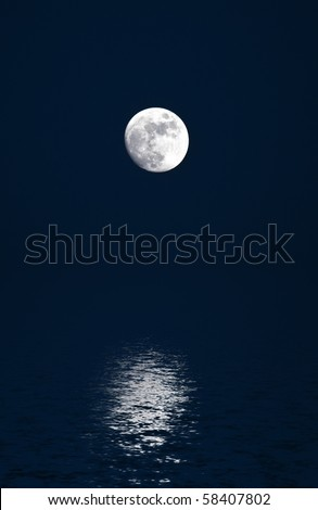 An almost full moon refelcted in ocean waters