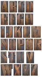 An alphabet of wooden printers' blocks silhouetted.