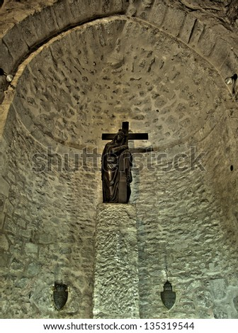 An altar in the Church of the Holy Sepulchre depicting Maria Magdalene holding the cross.