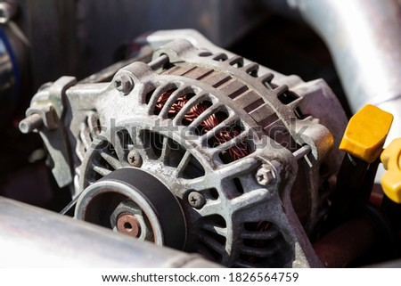 An alternator is an electrical generator that converts mechanical energy to electrical energy in the form of alternating current. Stock foto ©