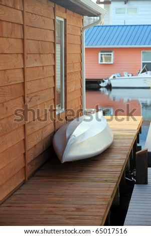 An aluminum boat on the patio. - stock photo