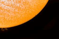 An amazing astronomical event, Planet Mercury transit over the Sun surface, 11th November 2019. We can see the tiny size of Mercury compare to the Sun disk and Sun flares on an H Alpha telescope view